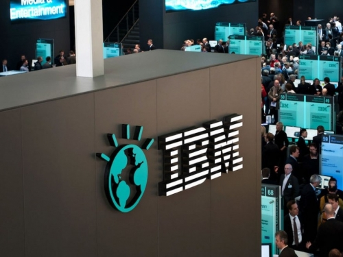 IBM shares rise as suits make a return