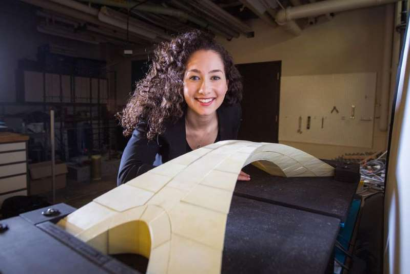 a woman smiling for the camera mit graduate student karly bast shows off a scale model of a bridge d 60575